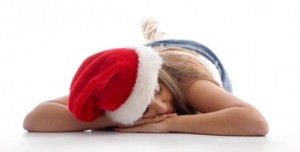sleeping female wearing christmas hat