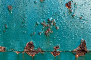 Corrosion occurring on a metal door.
